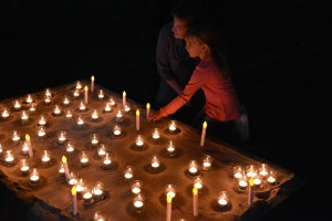Attendees at last night's vigil light candles to remember those who have lost their lives to domestic and family violence.