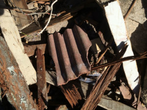 Dumped material containing asbestos